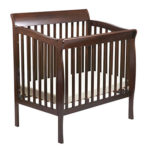 5. Delta Children Products Riley Mini Crib - Dark Cherry