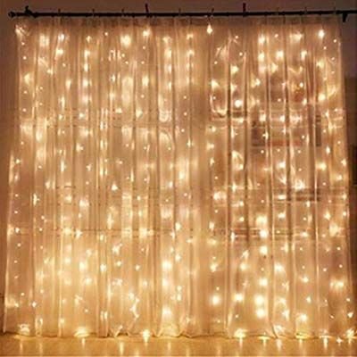 4. Twinkle Star 300 LED Window Curtain String Lights